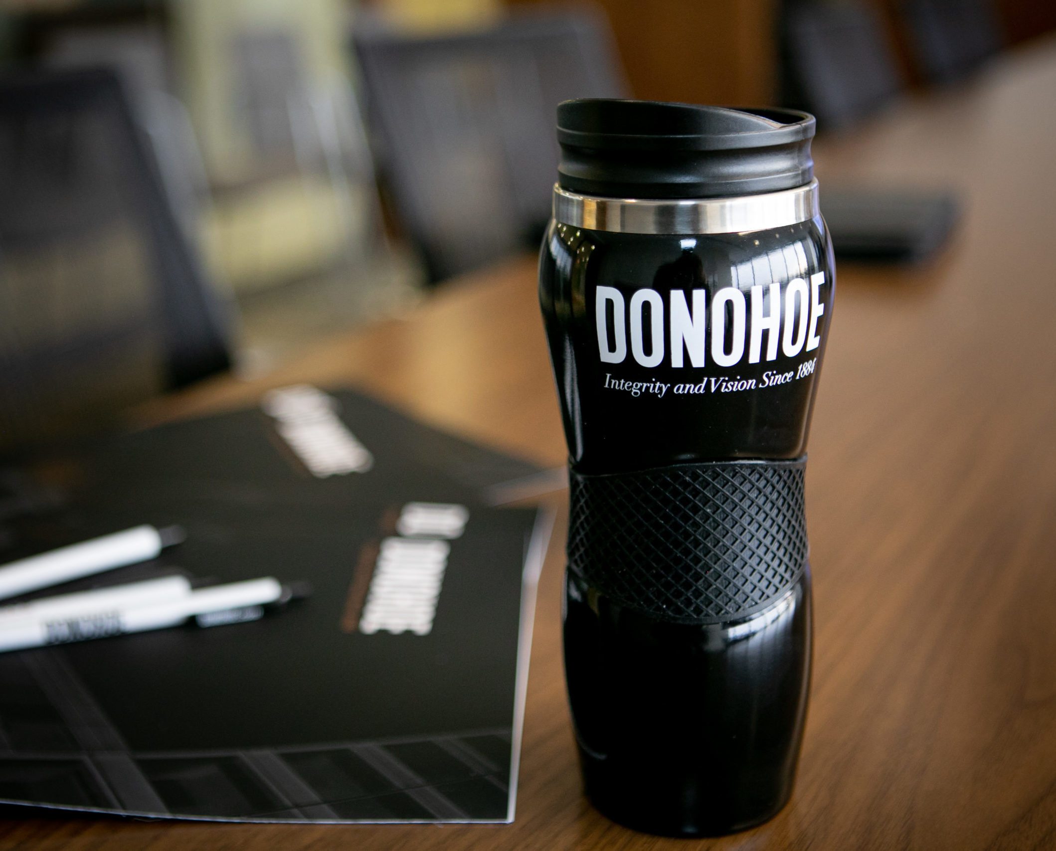 Donohoe branded business folder, pens and coffee flask